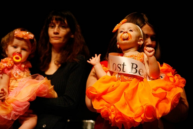 Babies in bright oragne dresses at the Southern Celebrity Beauty Pageant in Charleston, West Virginia as seen in Toddlers & Tiaras.TLC/Rebecca Drobis - Friday, January, 23, 2009, 10:23 PM